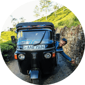 Andra & Vlad driving a tuktuk in Sri Lanka
